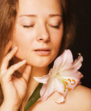 Beauty young woman with flower Royalty Free Stock Photography