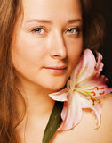 Beauty young woman with flower Royalty Free Stock Photo