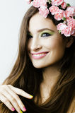 Beauty young woman with flowers and make up Royalty Free Stock Image