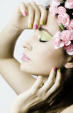 Beauty young woman with flowers and make up Stock Images