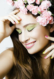 Beauty young woman with flowers and make up Royalty Free Stock Photography