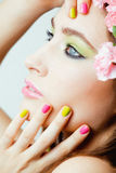 Beauty young woman with flowers and make up Stock Photos