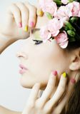 Beauty young woman with flowers and make up close Stock Photo