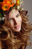 Beauty young woman with flowers and make up Royalty Free Stock Images
