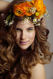 Beauty young woman with flowers and make up Stock Photography