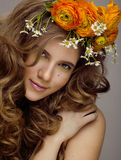 Beauty young woman with flowers and make up close Royalty Free Stock Photography
