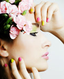 Beauty young woman with flowers and make up close up Stock Photos