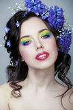 Beauty young woman with flowers and make up close up, real spring beauty. Beauty young woman with blue flowers and make up close up, real spring beauty stock photography