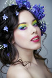 Beauty young woman with flowers and make up close up, real spring beauty. Beauty young woman with blue flowers and make up close up, real spring beauty stock photo