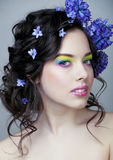 Beauty young woman with flowers and make up close up, real spring beauty. Beauty young woman with blue flowers and make up close up, real spring beauty stock images