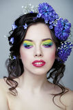 Beauty young woman with flowers and make up close up, real spring beauty. Beauty young woman with blue flowers and make up close up, real spring beauty royalty free stock photography