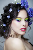 Beauty young woman with flowers and make up close up, real spring beauty. Beauty young woman with blue flowers and make up close up, real spring beauty royalty free stock images