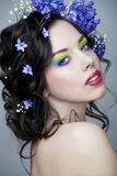 Beauty young woman with flowers and make up close up, real spring beauty. Beauty young woman with blue flowers and make up close up, real spring beauty stock photos