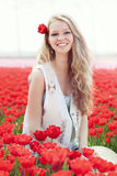 Beauty young woman with flowers tulips Royalty Free Stock Image