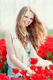Beauty young woman with flowers tulips Royalty Free Stock Photo