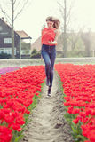 Beauty young woman with flowers tulips Royalty Free Stock Images