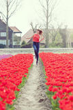 Beauty young woman with flowers tulips Stock Photography