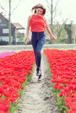 Beauty young woman with flowers tulips Stock Photos
