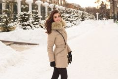Young woman in winter park Royalty Free Stock Images