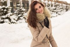 Young woman in winter park Royalty Free Stock Image