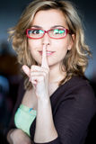 Beauty young woman gesturing silence. Beauty young woman with finger on lips. Close-up Stock Image
