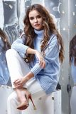 Beauty young woman glamor model businesswoman fashion clothes la. Dy wear casual style for date wool sweater baby blue color white pants pretty face dark natural stock images