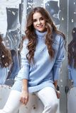 Beauty young woman glamor model businesswoman fashion clothes la. Dy wear casual style for date wool sweater baby blue color white pants pretty face dark natural royalty free stock photos