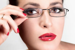 Beauty Young Woman with Glasses. Beauty Brunette. Brown Eyes. Portrait macro of young woman with glasses Stock Photos