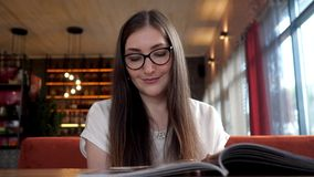 Beauty young woman reading menu. stock footage
