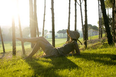 Beauty young woman on golf fiel relaxing Stock Photos