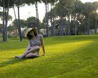 Beauty young woman on golf fiel relaxing Royalty Free Stock Photos