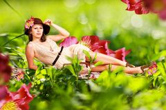 Beauty young woman in green grass Royalty Free Stock Photos