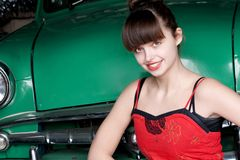 Beauty young woman with green retro car Stock Image