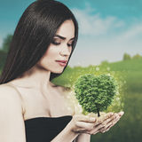 Beauty young woman with green tree. In her hands. ECO concept Royalty Free Stock Images