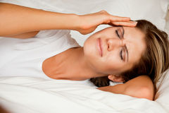 Beauty, young woman with headache Royalty Free Stock Images