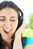 Beauty young woman with headphones Royalty Free Stock Images