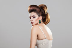 Beauty young woman with healthy skin creative hairstyle and nice Royalty Free Stock Image