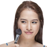 Beauty young woman her applying blusher Royalty Free Stock Photography