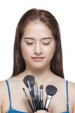 Beauty young woman holding make up brushes Stock Images