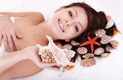 Beauty young woman holding starfish. Stock Photography
