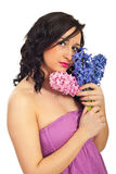Beauty young woman with hyacinth bouquet Royalty Free Stock Images