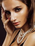 Beauty young  woman with jewellery close up, luxury portrait of rich real girl, party makeup. Beauty young sencual woman with jewellery close up, luxury portrait Royalty Free Stock Photo