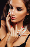 Beauty young  woman with jewellery close up, luxury portrait of rich real girl, party makeup. Beauty young sencual woman with jewellery close up, luxury portrait Royalty Free Stock Images
