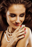 Beauty young  woman with jewellery close up, luxury portrait of rich real girl, party makeup Stock Image