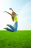 Beauty young woman jump in field Royalty Free Stock Photos