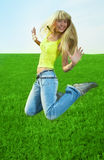 Beauty young woman jump in field Royalty Free Stock Photography