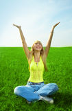 Beauty young woman jump in field Royalty Free Stock Image