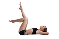 Beauty young woman lay on white in fitness dress stock photo