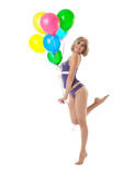 Beauty young woman in lingerie dance with balloons Stock Image