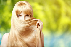 Beauty young woman with luxurious long blond hair. Girl with fre Royalty Free Stock Images